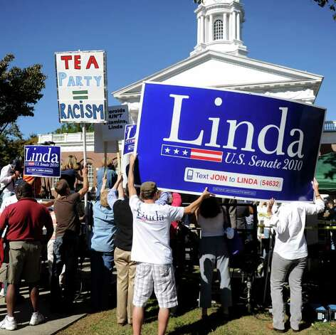 A protester stands among McMahon supporters during the Linda McMahon rally in Milford on Saturday, October 9, 2010. Photo: Lindsay Niegelberg / Connecticut Post