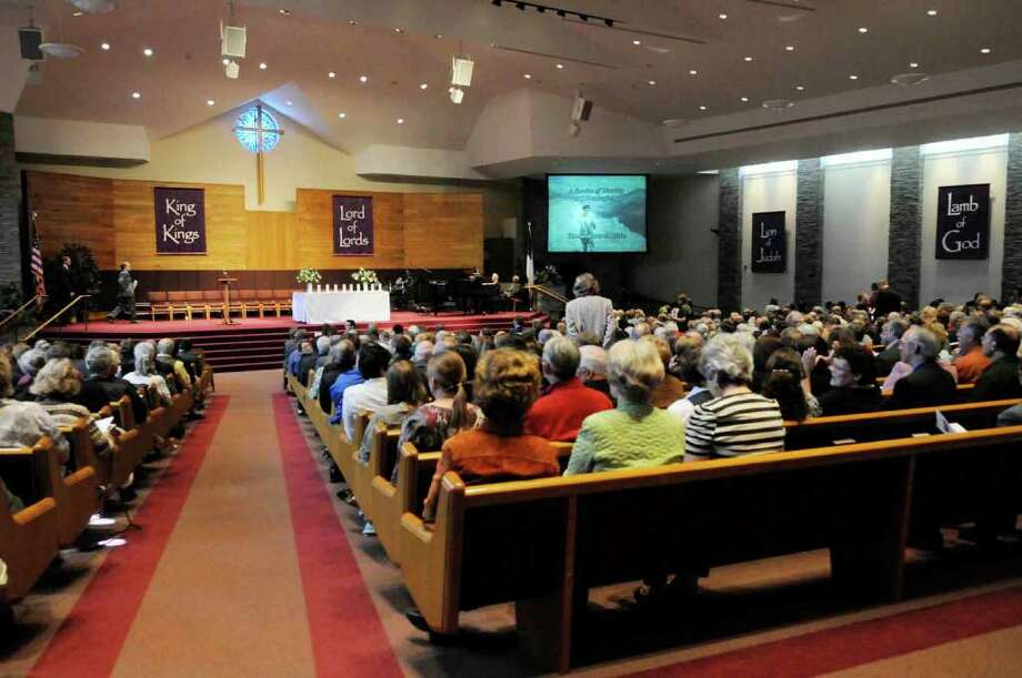 About 900 people attend the memorial service for Tom Little, an optometrist killed in Afghanistan in early August while on an international medical team, at the Loudonville Community Church on Oct. 9. (Michael P. Farrell / Times Union) Photo: Michael P. Farrell
