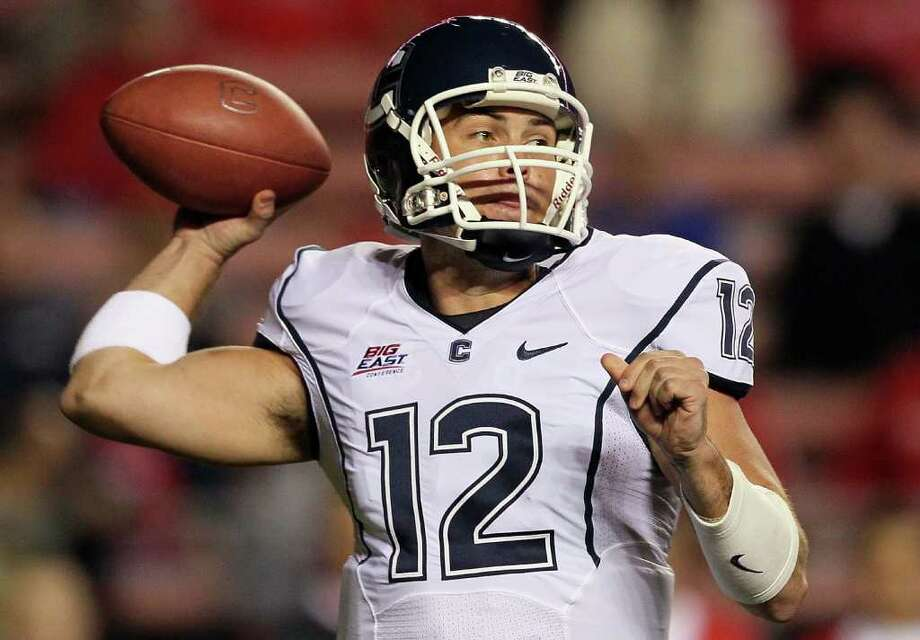 PISCATAWAY, NJ - OCTOBER 08:  Cody Endres #12 of the Connecticut Huskies throws a pass against the Rutgers Scarlet Knights at Rutgers Stadium on October 8, 2010 in Piscataway, New Jersey.  (Photo by Jim McIsaac/Getty Images) *** Local Caption *** Cody Endres Photo: Jim McIsaac, Getty Images / 2010 Getty Images