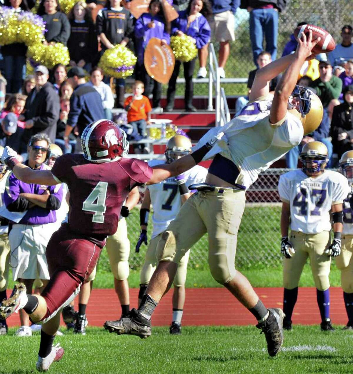 High school football -- Amsterdam's Nick Liverio, right, gets away from Burnt Hills' Evan Nusbaum to complete a pas. (John Carl D'Annibale / Times Union)