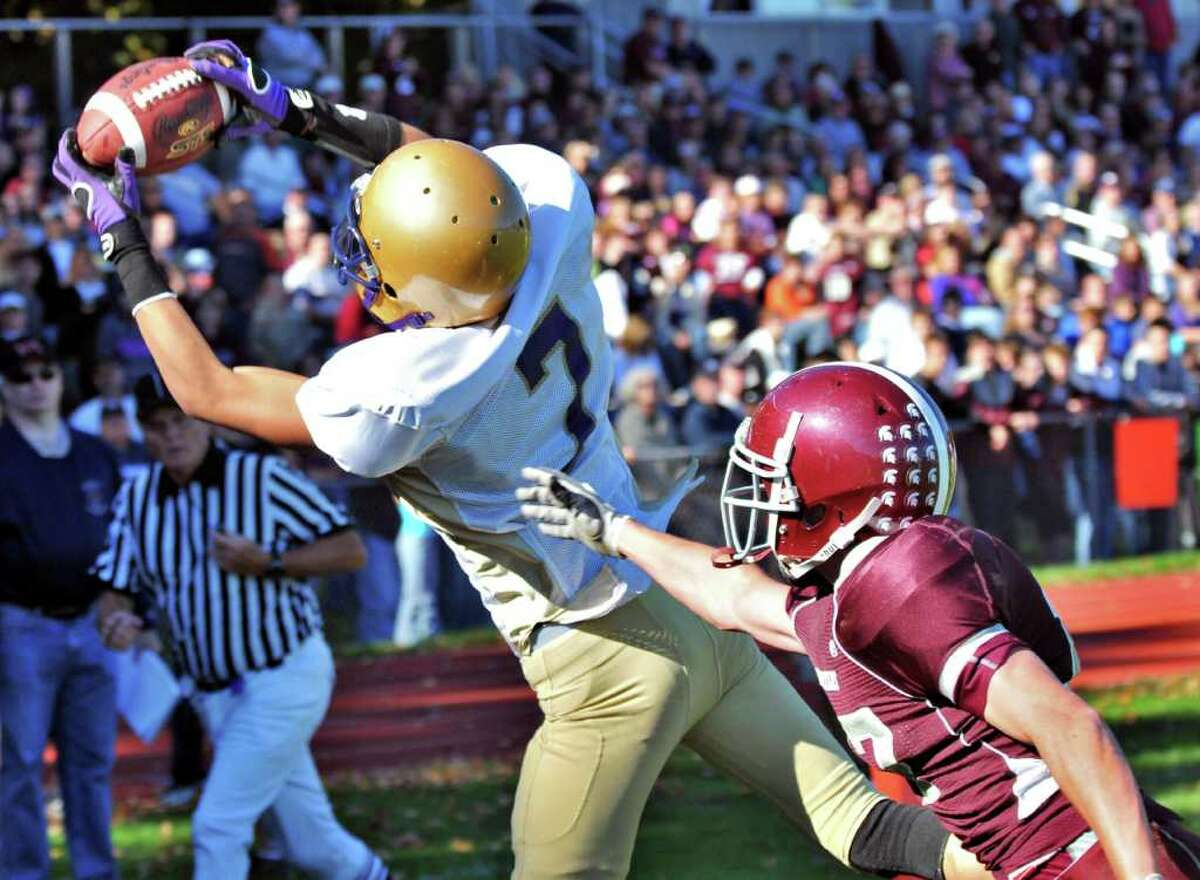High school football -- Amsterdam's Hector Julia (7) gets by Burnt Hills' Alexander Lewwk to catch a touchdown pass. (John Carl D'Annibale / Times Union)