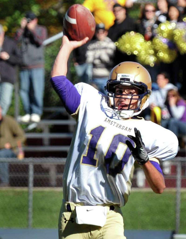 High school sports -- Amsterdam quarterback Bobby Noto gets a pass off against Burnt Hills. (John Carl D'Annibale / Times Union)