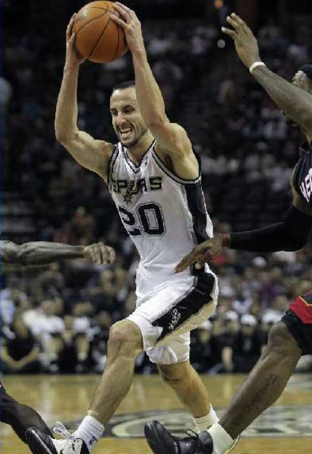 The Spurs' Manu Ginobili drives past the Heat's LeBron James during the first quarter Saturday at the AT&T Center.