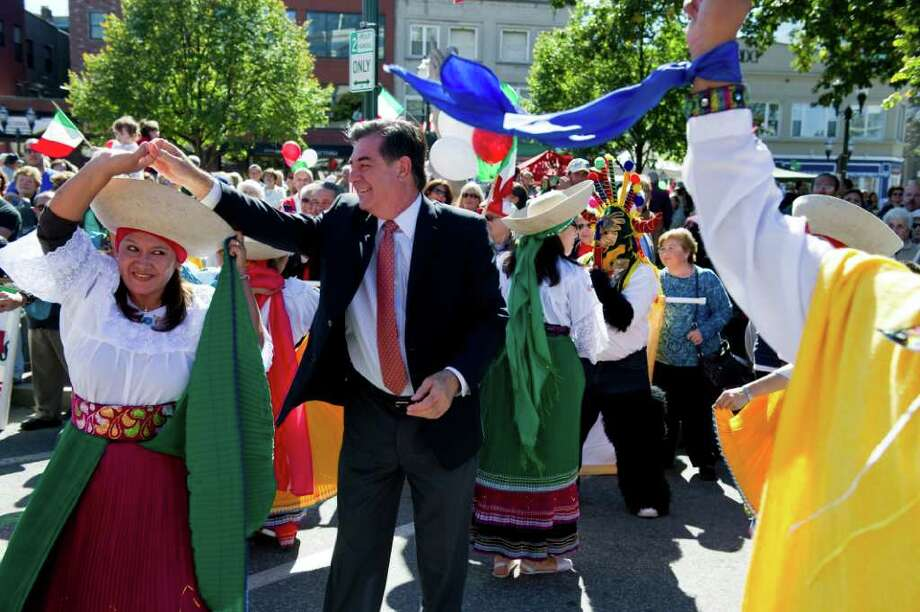 "Mayor Michael Pavia spins Wilma Paster as the ""Grupo de Danza"" brings Ecuadorian culture to the Columbus Day Parade from Sacred Heart Church on Schyler Avenue down Broad and Atlantic Streets to Columbus Park Sunday October 10, 2010. The festivities featured live music, dancing and Italian specialties. Photo: Keelin Daly / Stamford Advocate"