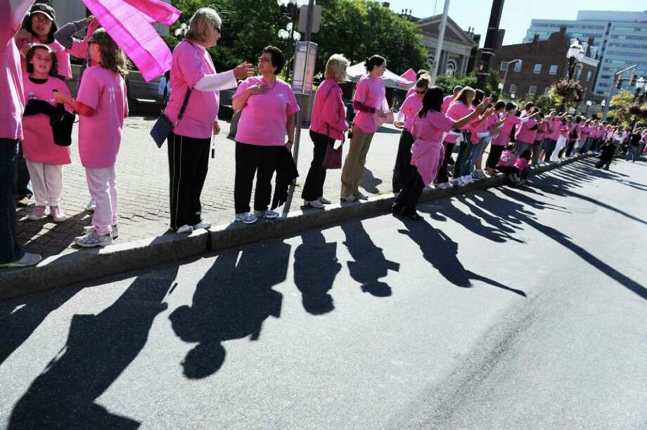 Family members. friends and breast cancer survivors gather along Atlantic Street in Stamford earlier this month to create a 'Mile of Pink.' The third annual 'Mile of Pink' is a 90-minute show of unity and a demonstration of breast cancer awareness. The event kicks off Stamford Hospital's month-long annual 'Paint the Town Pink' campaign. Photo: Kathleen O'Rourke, ST / Stamford Advocate