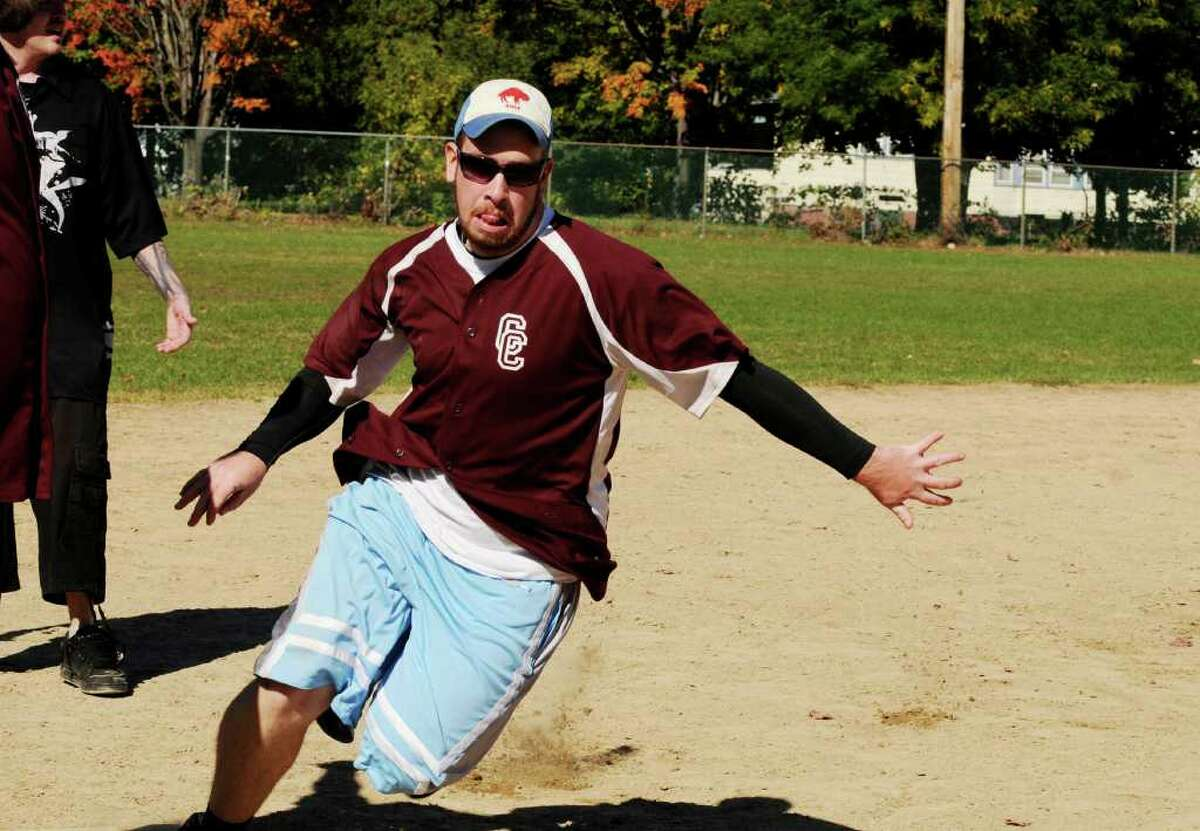 Tom Frowein of Ballston Spa, a member of the Cleats and Cleavage Kickball Team, rounds third base to score a run against the Netter's Team at the second annual Kickball Tournament to support Netter's Fund at Knickerbacker Park in Lansingburgh on Sunday, Oct. 10, 2010. (Luanne Ferris / Times Union)