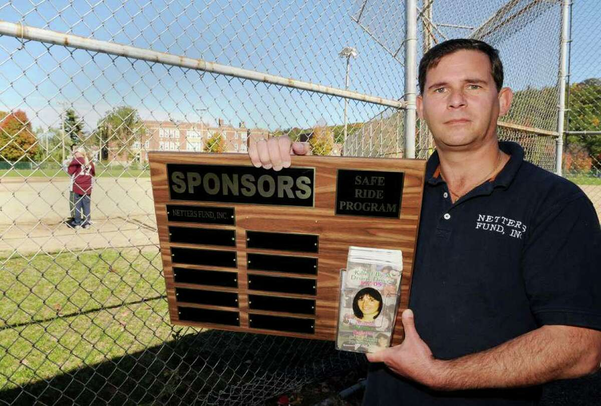 Mark Balistreri of Netter's Team holds a commemorative plaque at the second annual Kickball Tournament to support Netter's Fund at Knickerbacker Park, in Lansingburgh on Sunday, Oct. 10, 2010. The tournament raises funds to provide for the Annette