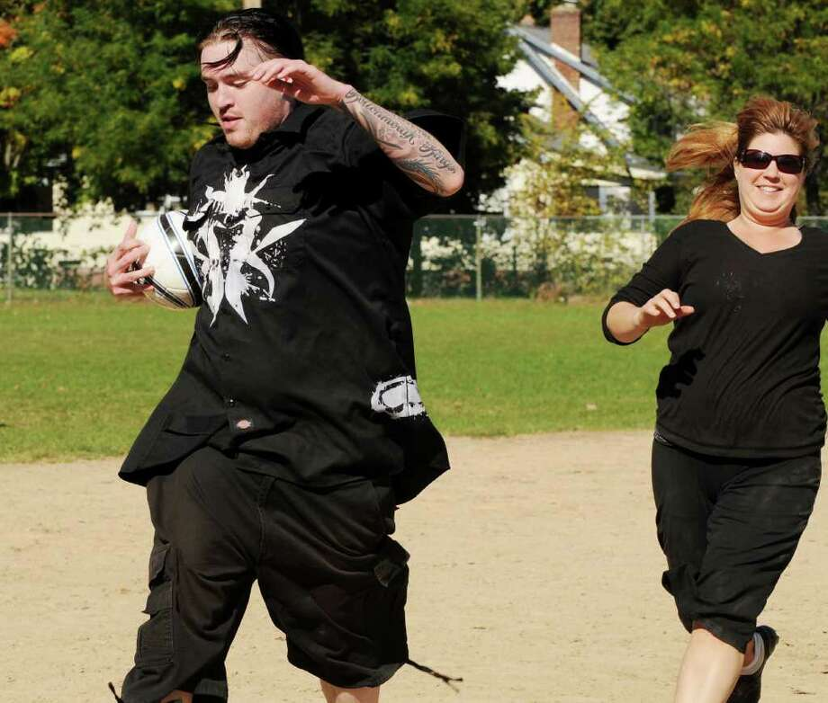 "Third baseman Steve Miller of Albany fields a ground ball and hustles to the bag to get the force out on a running Michele Van Epps of Ballston Spa at  this year's Kickball Tournament, to support Netter's Fund  at Knickerbacker Park, in Lansingburgh, on Sunday, Oct. 10, 2010.   The fund, which pays for free rides home for customers at local bars was founded by Mark Balistreri of Troy in 2005 after his wife, Annette ""Netter"" Balistreri, was killed by a drunken driver.  (Luanne Ferris / Times Union) Photo: Luanne M. Ferris"