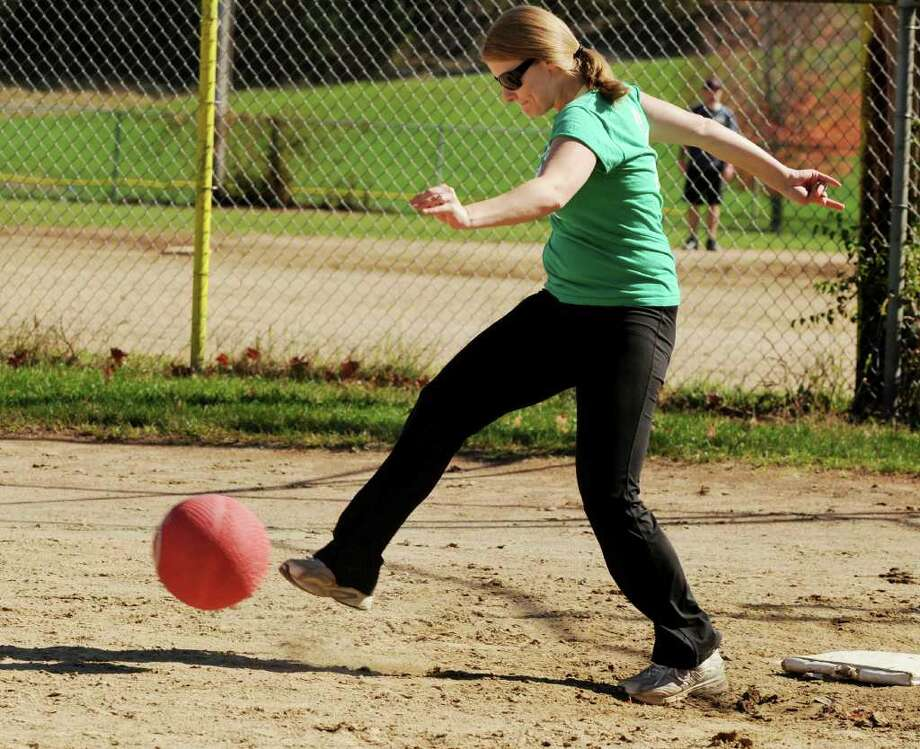 Danielle Mazzariello, first baseman for Netter's Team, kicks the pitch from the Cleats and Cleavage Team at the Kickball Tournament to support Netter's Fund  at Knickerbacker Park in Lansingburgh on Sunday, Oct. 10, 2010. (Luanne Ferris / Times Union) Photo: Luanne M. Ferris