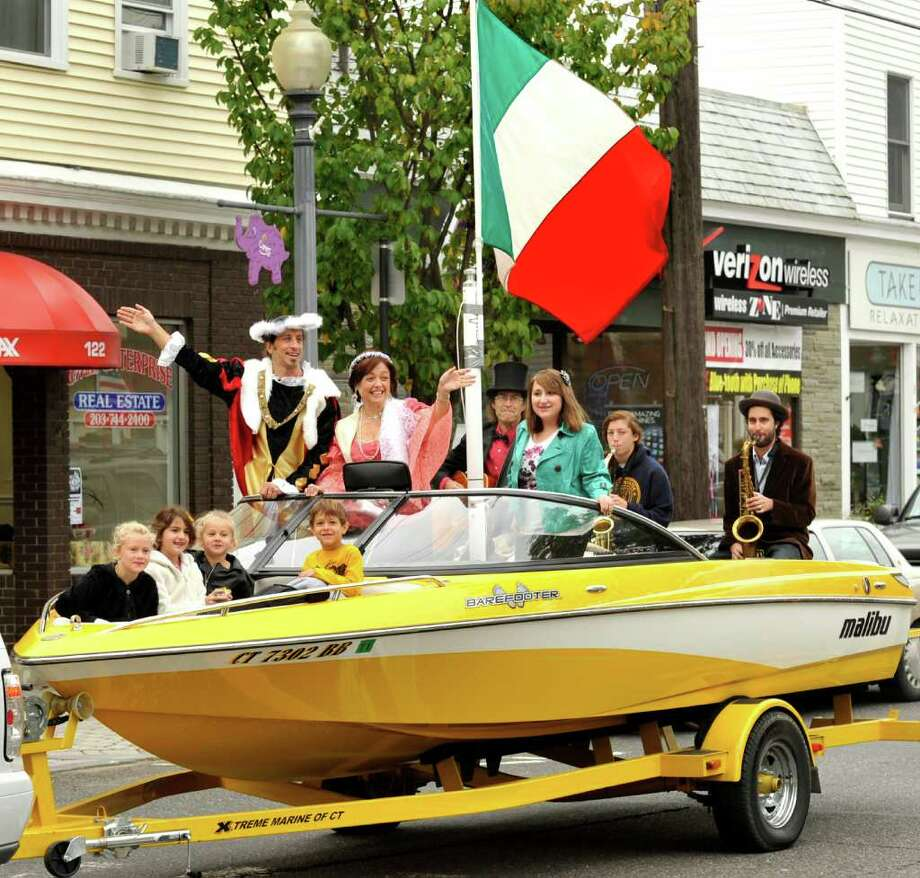The annual Columbus Day parade makes its way down Greenwood Avenue, Bethel, Monday, Oct. 11, 2010. From left are Sarah Volpintesta, Emma Mortara, both 8, Rosie Volpintesta, 5, Rob Volpintesta as Christopher Columbus, Jake Caraluzzi, 6, Gina Clarizio as Queen Isabella, Billy Michael, Maria Lostocco, 13,  Julia Buzak, 15, and Will Michael on sax. Photo: Michael Duffy / The News-Times