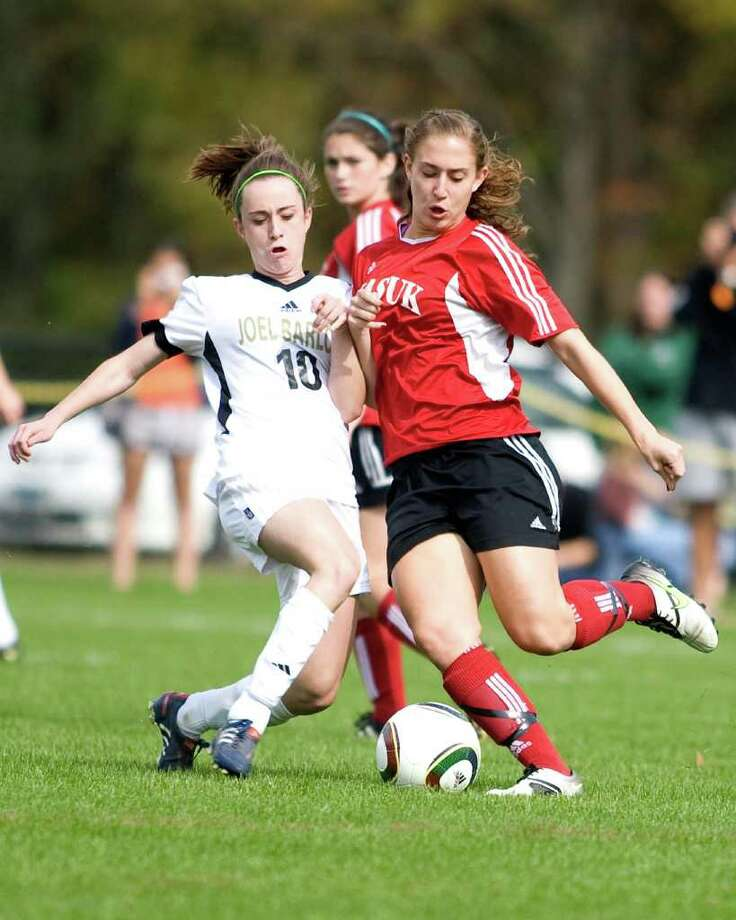 Barlow's Lilly Creighton (10) tackles the ball away from Masuk's Kelly Zazuri during their SWC match Monday at Joel Barlow High. Photo: Barry Horn / The News-Times Freelance