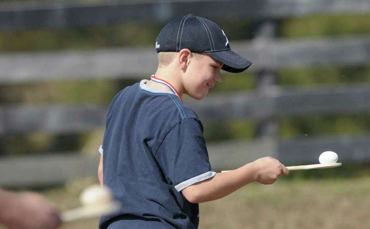 Nicholas Koper, 9, from Ballston Spa takes part in an egg race during the Family Farm Olympics at Liberty Ridge Farm in Schaghticoke, NY, on Monday, Oct. 11, 2010. (Paul Buckowski / Times Union)