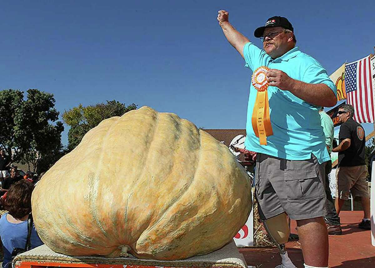 HALF MOON BAY, CA - OCTOBER 11: Ron Root of Citrus Heights, California celebrates after winning the 37th Annual Safeway World Championship Pumpkin Weigh-Off with his 1,535 pound pumpkin on October 11, 2010 in Half Moon Bay, California. Ron Root took home $9,210 for his massive pumpkin, or $6 a pound. (Photo by Justin Sullivan/Getty Images) *** Local Caption *** Ron Root