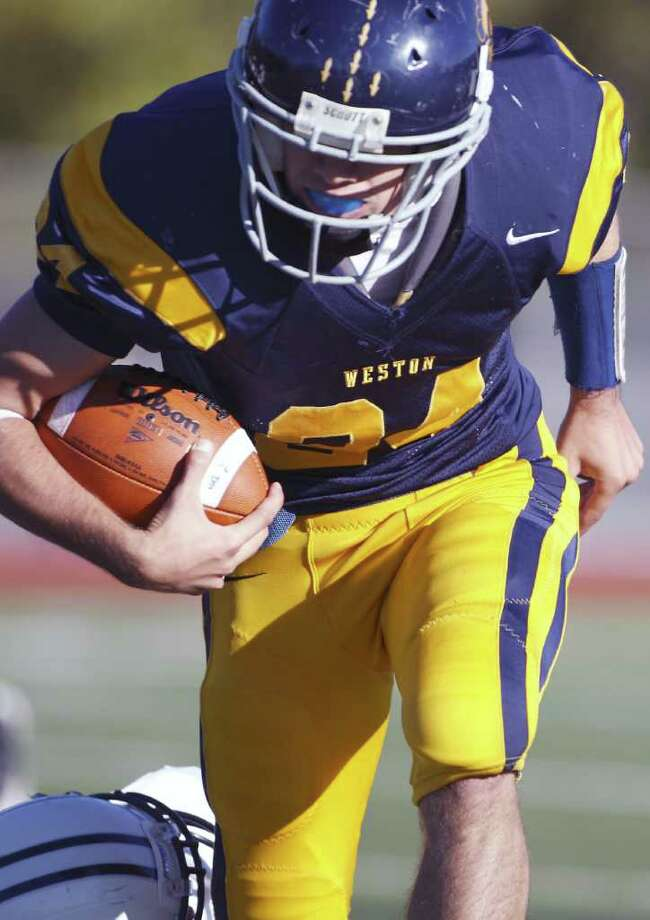 HIghlights from the Weston Trojans vs. Immaculate Mustangs football on Saturday, October 9th in a 3:00p start in Weston. Photo: David E. Johnston / Connecticut Post Freelance