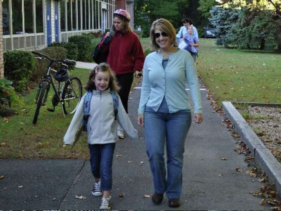 Holland Hill PTA President Tracie Haner Valentino walks to school with her daughter, Madeline Valentino, a second-grader at Holland Hill. The two are participating in the school's walk to school day on Friday, Oct. 8, 2010. Photo: Contributed Photo / Fairfield Citizen contributed