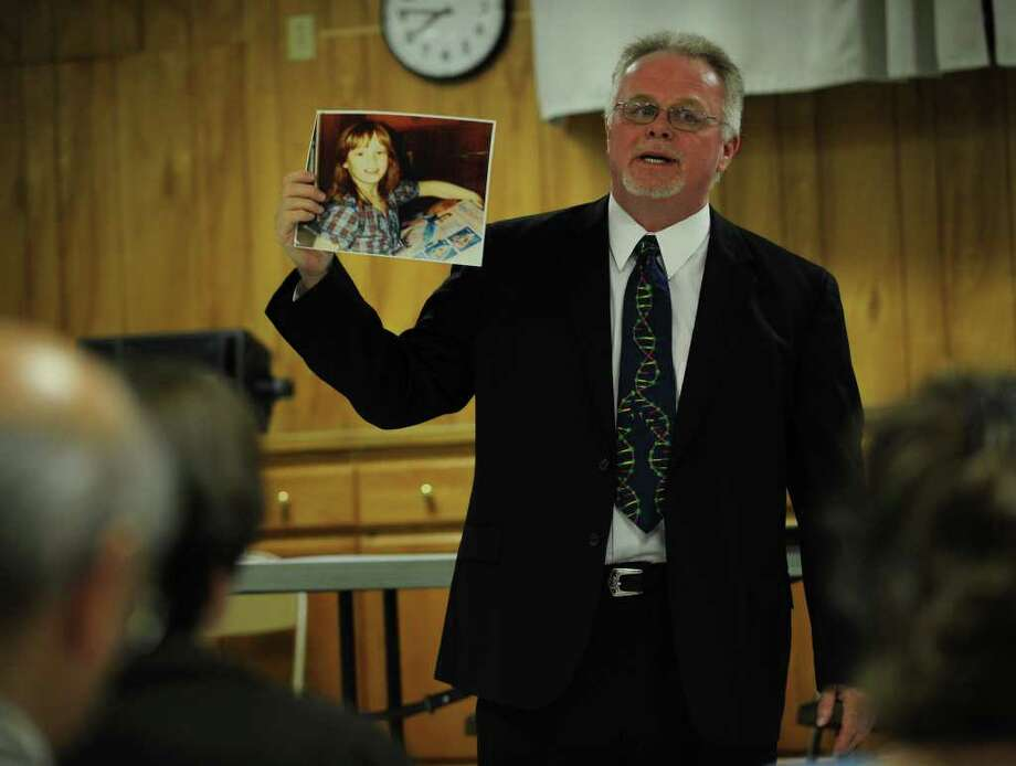 Kirk Bloodsworth shows of photo of nine-year-old Dawn Hamilton during a talk at the Knights of Columbus Hall in Milford on Monday, October 11, 2010. Bloodsworth was sentenced to death for Hamilton's 1984 murder, and later exonerated because of DNA evidence. Photo: Brian A. Pounds / Connecticut Post