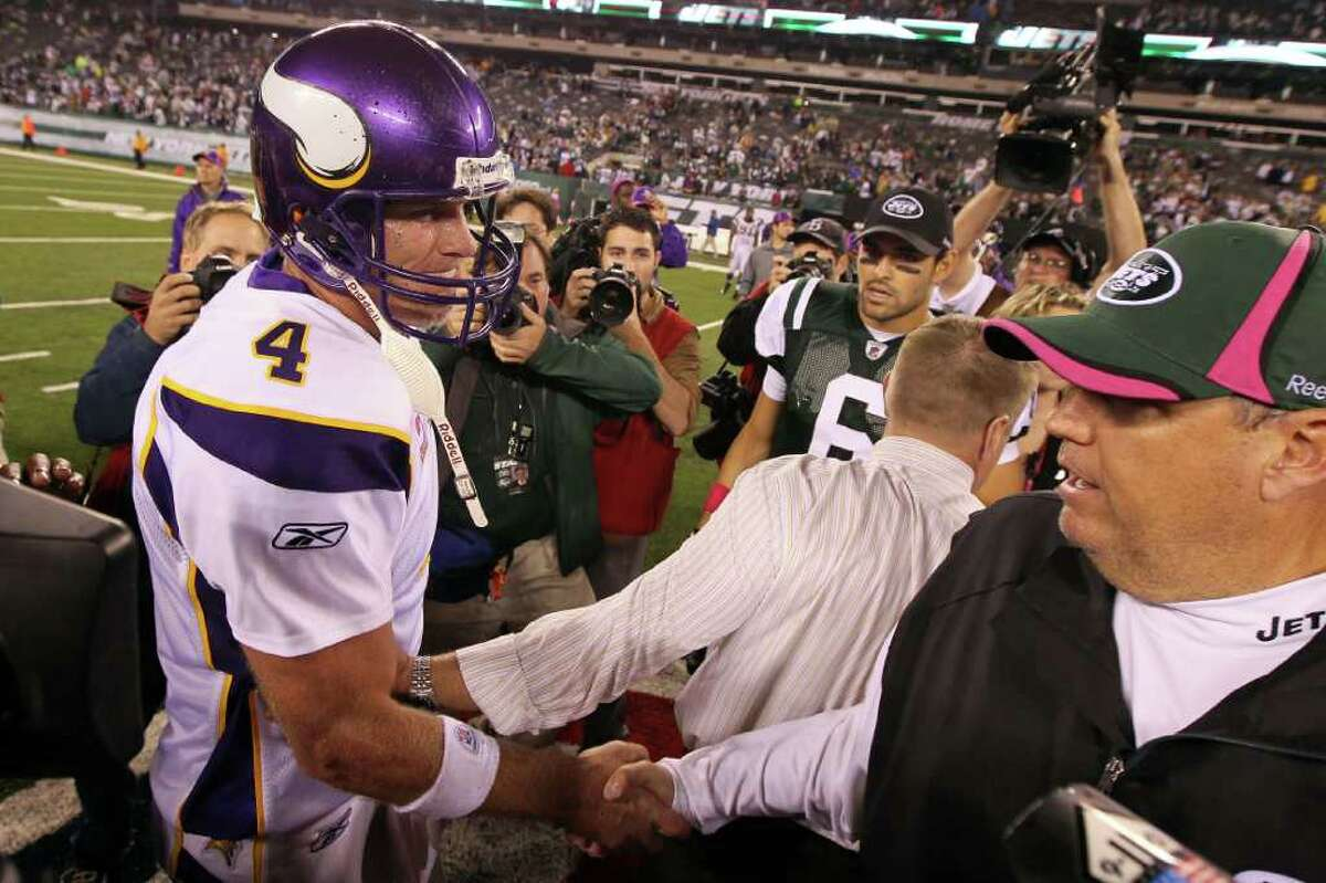 EAST RUTHERFORD, NJ - OCTOBER 11: Brett Favre #4 of the Minnesota Vikings congratulates head coach Rex Ryan of the New York Jets won 29-20 at New Meadowlands Stadium on October 11, 2010 in East Rutherford, New Jersey. (Photo by Jim McIsaac/Getty Images) *** Local Caption *** Brett Favre;Rex Ryan