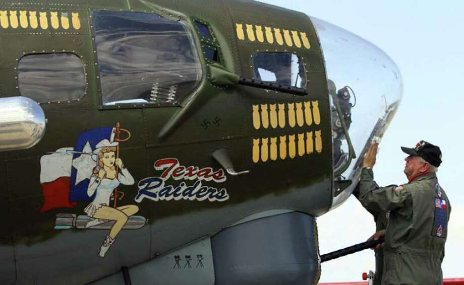 Chuck Conway cleans the nose of the Commemorative Air Force's B-17 Flying Fortress in Hondo. Walk-through tours of the bomber will be offered for donations from 9 a.m. to 2 p.m. at the airfield Tuesday, followed by flights for $425.