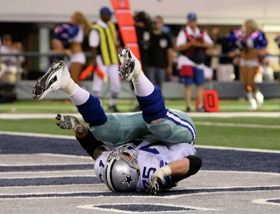 Cowboys lineman Marc Colombo falls to the ground after a touchdown celebration that drew a 15-yard penalty on the ensuing kickoff.