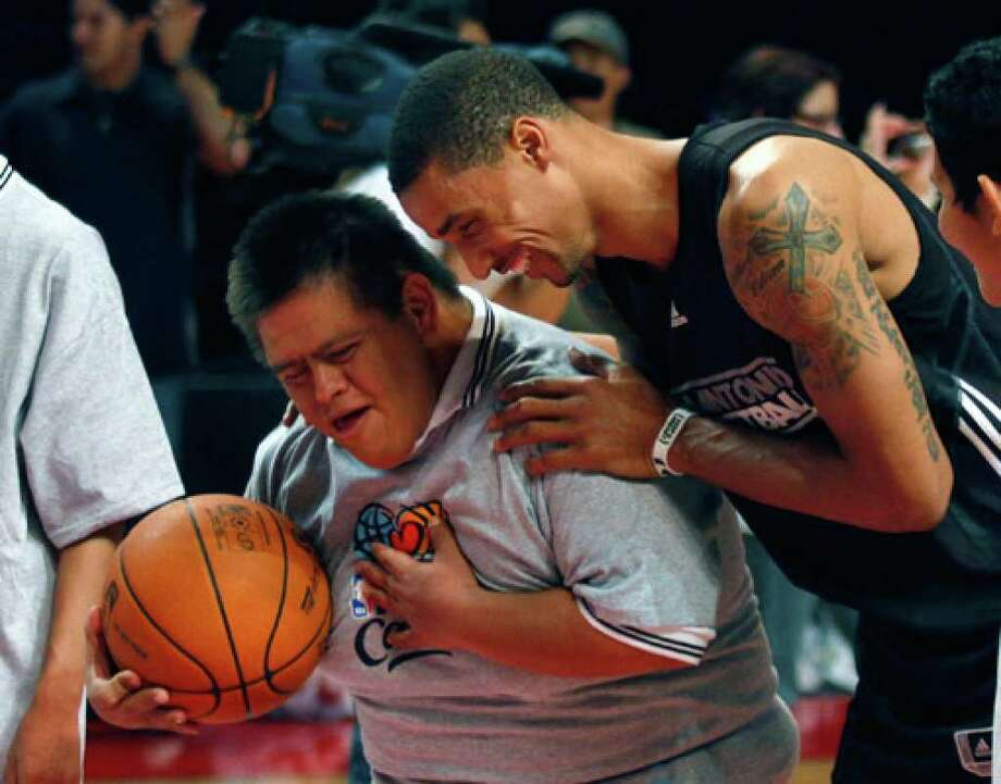 Spurs guard George Hill jokes with a boy who has Down syndrome during an NBA event in Mexico City on Monday. The Spurs will face the Los Angeles Clippers in a preseason game tonight at at Palacio de los Deportes.