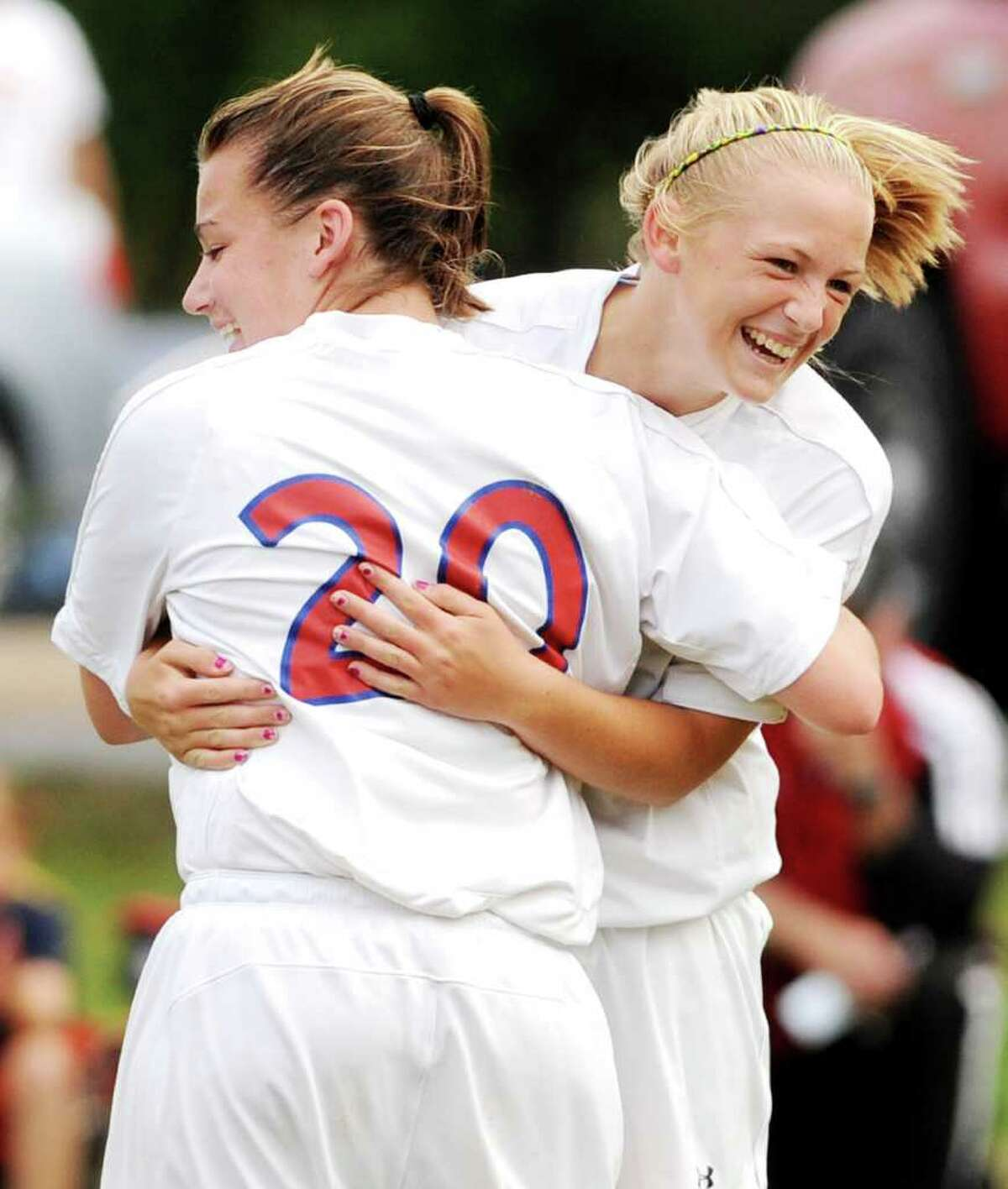 L-R: No. 20, Maple Hill Girls Varsity Soccer Star Meeghan Arno, celebrates as she hugs teammate, No. 8, her fellow senior striker, and team captain, Sierra Legge, after her second goal of the game and the 130th goal in her varsity career at the high school, in a game vs. Cambridge Central High School, held at Maple Hill in Schodack, NY, on Monday, Oct. 11, 2010. I believe Legge got the assist on the goal. Photos for daily sports coverage, a profile story on Arno, and for the web photo gallery. (Luanne M. Ferris / Times Union )