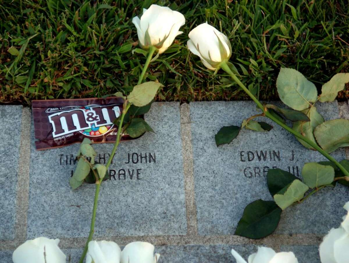 A pack of M&M's sits on the stone of Timothy John Hargrave at the state's 9/11 Living Memorial at Sherwood Island State Park in Westport, Conn. following the annual September 11 memorial ceremony Wednesday Sept. 9, 2009.