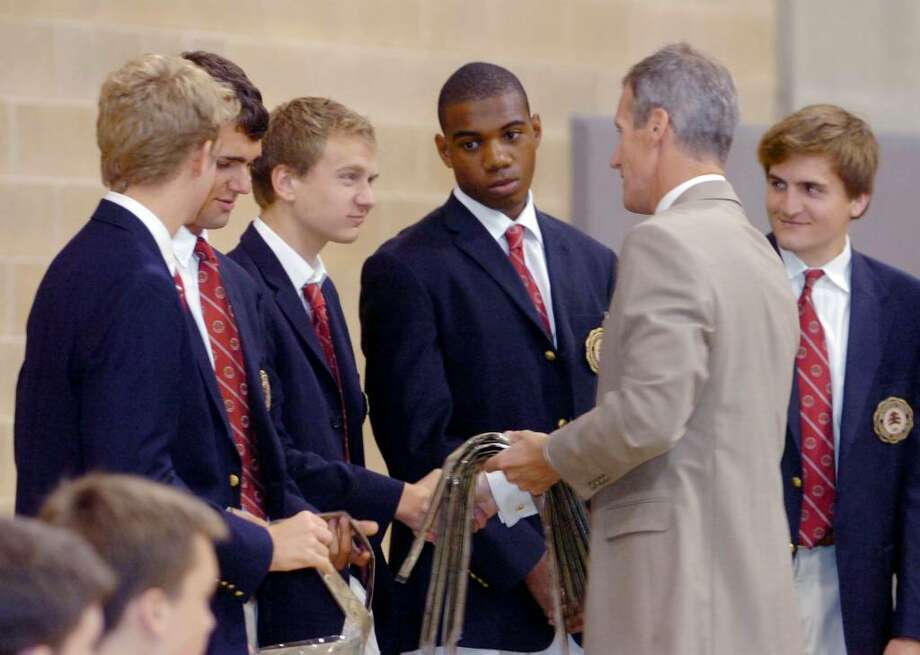 Greenwich, Sept.9, 2009. During the school's welcome ceremony,  Brunswick headmaster Thomas Philip hands out special gold ties for the seniors who have been elected a prefect during the year. From left they are Oliver Sall, Robin Malloch, Will Biondi, Lawrence Lopez and Alex Ghaffari.Brunswick School Senior Prefects are responsible for the 'tenor and tone'of the school year, sit on the student-run Discipline Committee for the Upper School, and are regularly asked to facilitate programs with Brunwich's Pre,Lower and Middle School students. Photo: Helen Neafsey / Greenwich Time