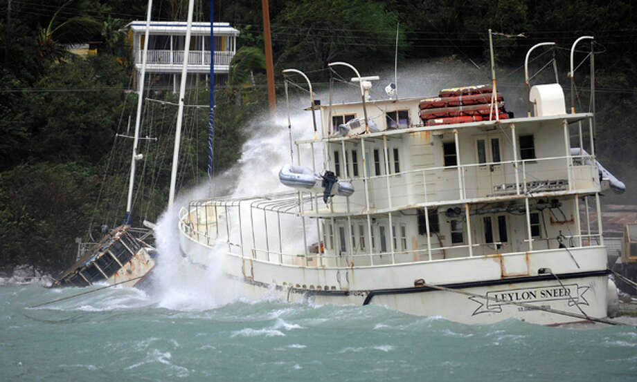 A boat is battered by waves in Sopers Hole during the passage of Hurricane Earl near Tortola, British Virgin Islands, Monday Aug. 30, 2010. The Category 4 hurricane was expected to remain over the open ocean before turning north and running parallel to the U.S. coast, potentially reaching the North Carolina coastal region by late Thursday or early Friday.  (AP Photo/Todd VanSickle) / AP