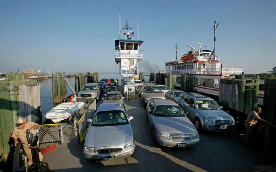 A ferry with cars traveling from Ocracoke Island docks in Hatteras, N.C., Wednesday, Sept. 1, 2010. An evacuation of Ocracoke is underway as Hurricane Earl approaches the North Carolina Outer Banks. (AP Photo/Gerry Broome) / AP