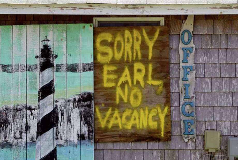A window is boarded up with a message at the Buxton Beach Motel in Buxton, N.C., Wednesday, Sept. 1, 2010 as Hurricane Earl approaches North Carolina's Outer Banks. (AP Photo/Gerry Broome) / AP
