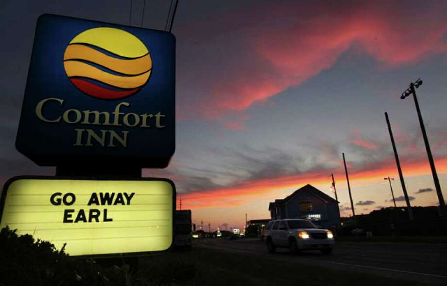 "A sign that reads ""Go away Earl"" outside a hotel is seen as the sun sets in Buxton, N.C. Wednesday, Sept. 1, 2010. Hurricane Earl steamed toward the Eastern Seaboard on Wednesday as communities from North Carolina to New England kept a close eye on the forecast, worried that even a slight shift in the storm's predicted offshore track could put millions of people in the most densely populated part of the country in harm's way. (AP Photo/The News & Observer, Chuck Liddy) / 2010 The News & Observer"