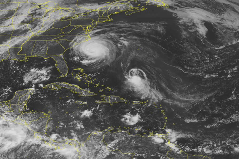 This NOAA satellite image taken Thursday at 01:45 PM EDT shows Hurricane Earl spinning about 300 miles south of Cape Hatteras, N.C.  Earl has reduced to category 3 strength with maximum sustained winds at 125 mph. The system pushes some clouds with light showers over the Carolinas.  To the south, Tropical Storm Fiona follows closely behind, currently sitting about 550 miles south of Bermuda kicking up winds up to 50 mph.  Another system, Tropical Depression Gaston, develops to the southeast in the Mid-Atlantic Ocean and quickly approaches the Lesser Antilles.  (AP Photo/Weather Underground) / WEATHER UNDERGROUND