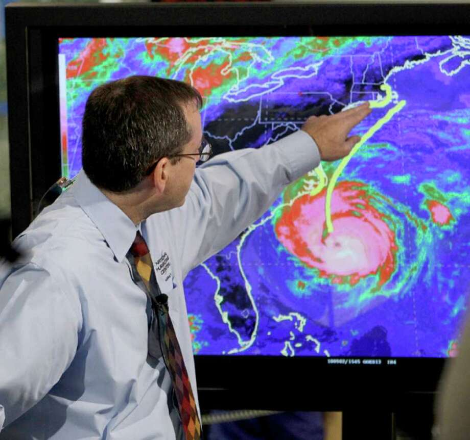 Chief hurricane forecaster James Franklin shows the projected path of Hurricane Earl up the east coast of the U.S.  during a live broadcast from the National Hurricane Center in Miami Thursday, Sept. 2, 2010. The Eastern Seaboard from North Carolina to Maine is on alert for a Labor Day weekend pounding by waves, gales and Rain.(AP Photo/Lynne Sladky) / AP