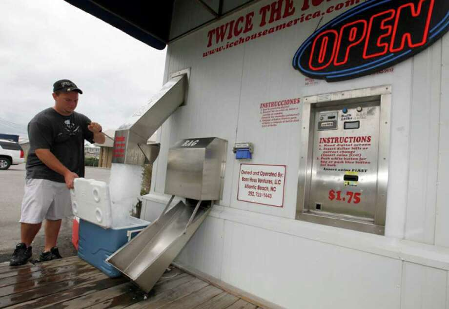 Lee Taylor, of Harlow, N.C., buys ice for his family to ride out the storm as Hurricane Earl heads toward the eastern coast in Atlantic Beach, N.C., Thursday, Sept. 2, 2010. (AP Photo/Chuck Burton) / AP