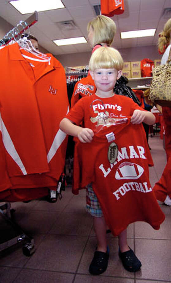 At the Kampus Corner Bookstore across from the campus, Jacob Beebe was shopping with his mother Jennifer Beebe. They were buying Lamar University T-shirts. The fever that is Lamar University's first home football game in over 20 years was especially evident in stores carrying anything Lamar related as people searched and bought their favorite Lamar merchandise.   Dave Ryan/The Enterprise