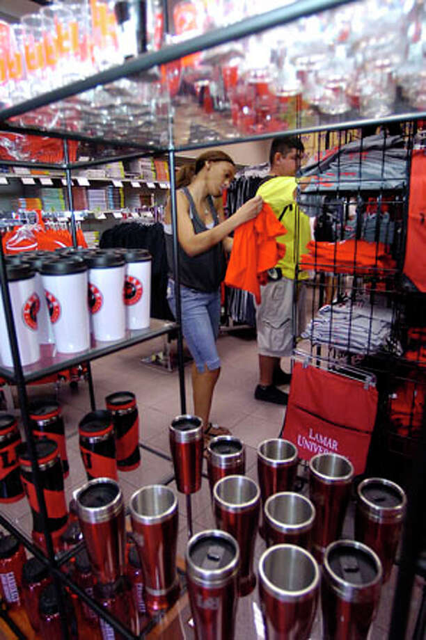 At the Kampus Corner Bookstore across from the campus, Deirdre Van Pelt was trying to decide between T-shirts for the Saturday game. The fever that is Lamar University's first home football game in over 20 years was especially evident in stores carrying anything Lamar related as people searched and bought their favorite Lamar merchandise.   Dave Ryan/The Enterprise