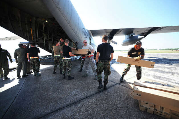 National Guard units from Texas and Delaware unload emergency supplies from a C-130 transport plane at the Southeast Texas Regional Airport. The plane was later used to airlift special needs patients to San Antonio. Guiseppe Barranco