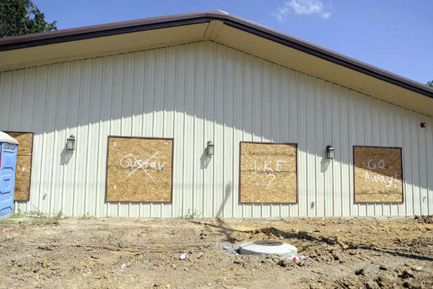 A boarded-up building on Texas 105 displays comments and the big question regarding Hurricane Ike's possible landfall. Valentino Mauricio