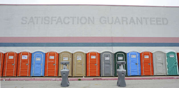 A row of portable toilets lines the wall of a former WalMart store, used as spill-over shelter for Southeast Texas evacuees in Tyler. Valentino Mauricio