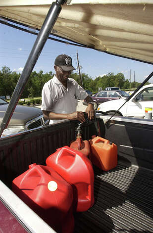 A.L. Jones fills several spare gas cans to fuel a generator he plans to use as he rides out Hurricane Ike in his Beaumont home.  Dave Ryan
