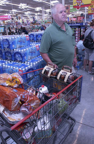Randy Moore stocks up on non-perishables and  supplies as he prepares to ride out Ike's landfall in his Beaumont home. Dave Ryan