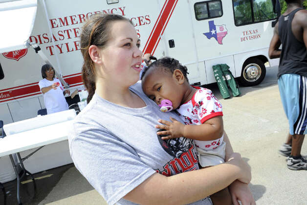 Evacuees, Penny McClendon, 17, of  Kirbyville, and her goddaughter, Olivinna McFarlane, arrived at the Salvation Army check-in station in Tyler to discover that all shelters in that area were filled to capacity and they needed to make alternative plans. Valentino Mauricio