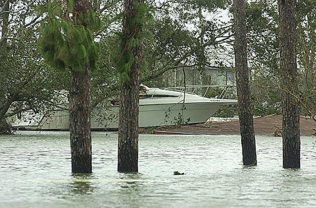 Water rose to the top of a residential garage, bringing a boat to rest on the garage roof at a home off Texas 73 near Port Acres. Guiseppe Barranco