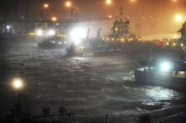 Tugboats anchored for safety in the Port of Beaumont thrash wildly as Hurricane Ike roars ashore. A ship captain estimated waters rose 11 feet at the port, almost lifting the vessels onto their docks. Guiseppe Barranco
