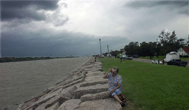 As Hurricane Ike approached, Jan Wilson went to Port Arthur's seawall to experience nature's power.  Dave Ryan