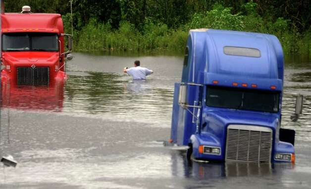 A man wades through chest high waters to get to his truck at a truck stop in Rose City the day Ike made landfall. Tammy McKinley