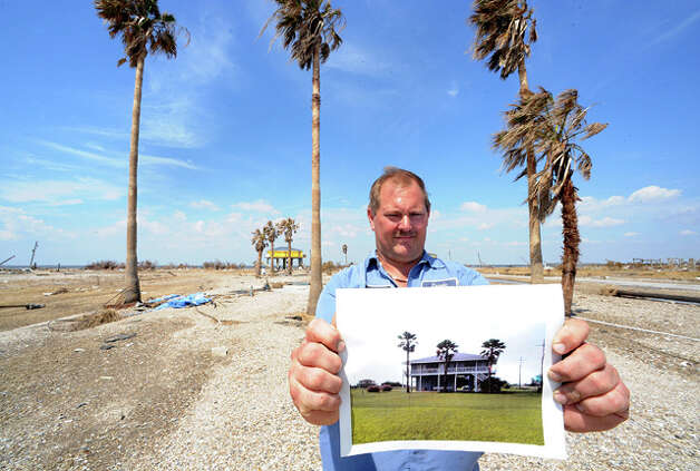 A before-the-storm photo of Damon Smith's beach cabin dramatically illustrates the power of Ike as he stands on the now-empty lot on Rollover Lane. Guiseppe Barranco