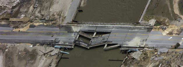Storm surge caused the collapse of a segment of the Texas 87 bridge at Rollover Pass.  Dave Ryan