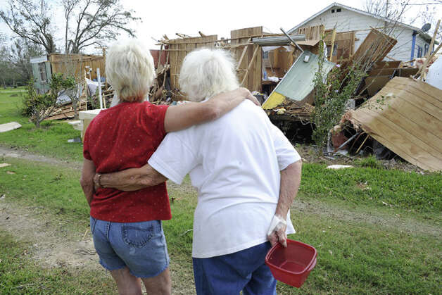 "Norma Rubin, left, surveys damage to her home with her neighbor, Mary Isaacks, in High Island.  Rubin's son, Herman ""PeeWee""  Thomas Moseley, died in the storm. Searchers found his body  on an island off Galveston Bay 12 days later.  Valentino Mauricio"