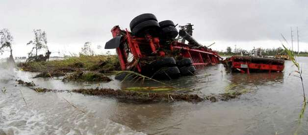An overturned truck lies in flood waters near Texas 87. Tammy McKinley